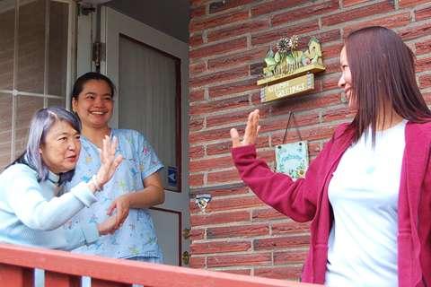 Caregiver Respite Grant Programs - Caregiver caring for elderly woman with family careviger